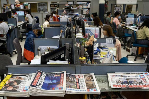PHOTO: Reporters work at the news room of Apple Daily Monday, April 26, 2021, in Hong Kong.  (Vincent Yu/AP)