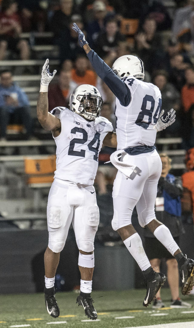 Penn State's Miles Sanders (24) and Juwan Johnson (84) celebrate a touchdown during the second half of an NCAA college football game against Illinois on Friday, Sept. 21, 2018, in Champaign, Ill. (AP Photo/Holly Hart)