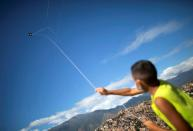 A boy flies a kite as the Petare neighbourhood celebrates the 400th anniversary of its founding in Caracas