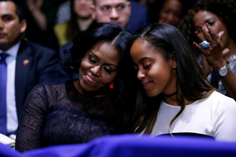 U.S. first lady Michelle Obama and her daughter Malia embrace as President Barack Obama praises them during his farewell address in Chicago, Illinois, U.S. January 10, 2017. (Photo: Jonathan Ernst/Reuters)