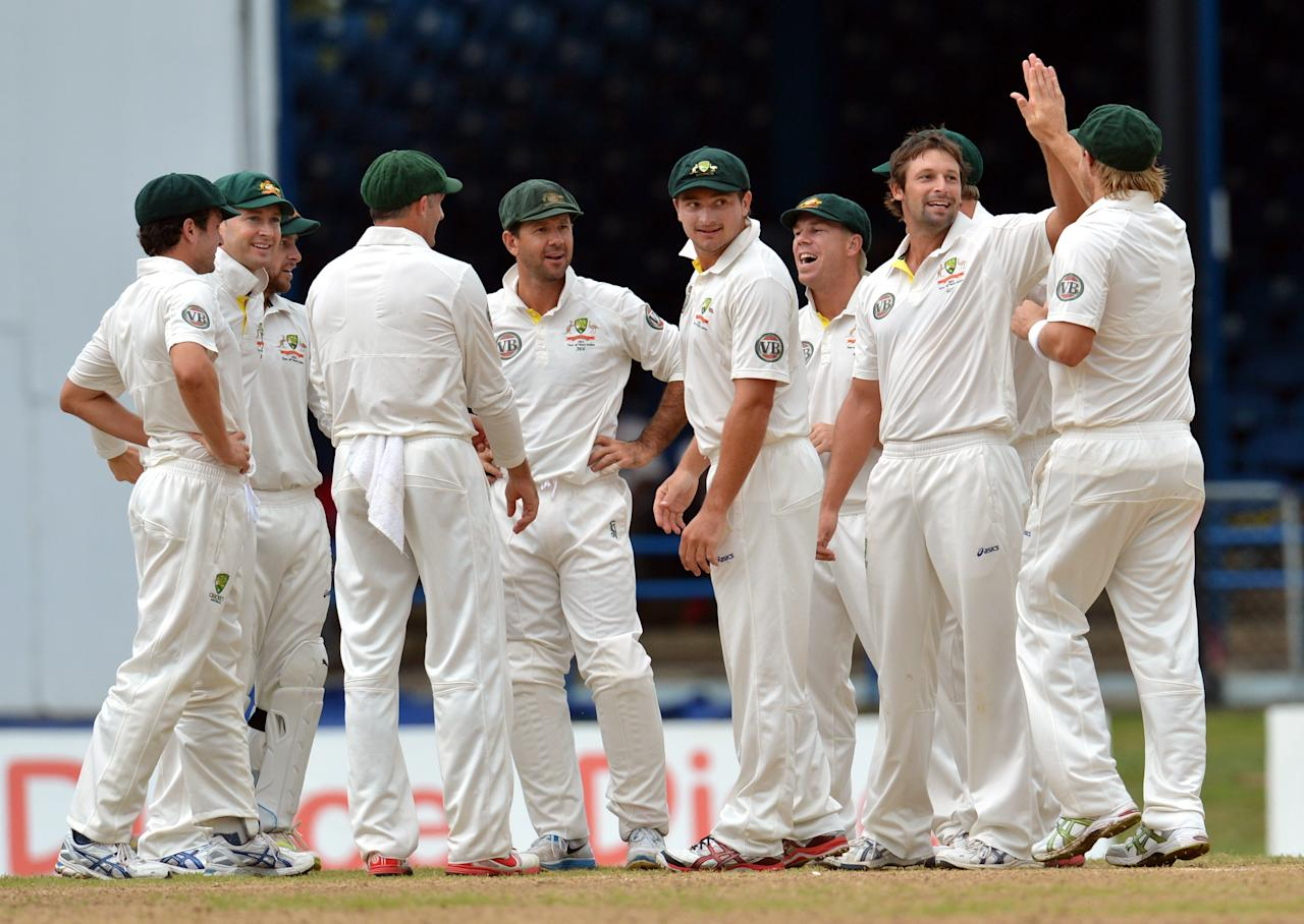 Australian bowler Ben Hilfenhaus (2nd R) and teammates celebrate LBW appeal against West Indies Kieran Powell during the final day of the second-of-three Test matches between Australia and West Indies April19, 2012 at Queen's Park Oval in Port of Spain, Trinidad.