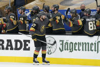 Vegas Golden Knights defenseman Shea Theodore (27) celebrates after scoring against the Montreal Canadiens during the first period in Game 1 of an NHL hockey Stanley Cup semifinal playoff series Monday, June 14, 2021, in Las Vegas. (AP Photo/John Locher)