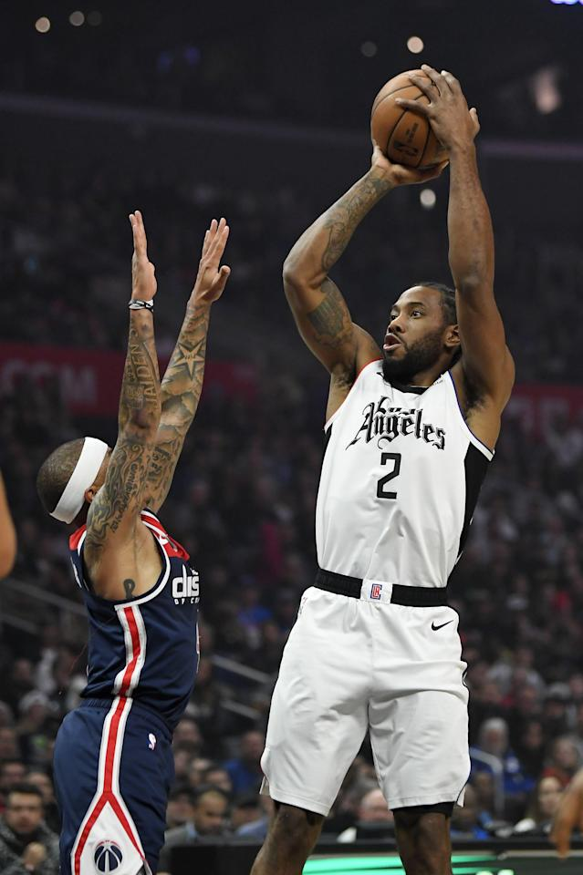 Los Angeles Clippers forward Kawhi Leonard, right, shoots as Washington Wizards guard Isaiah Thomas defends during the first half of an NBA basketball game, Sunday, Dec. 1, 2019, in Los Angeles. (AP Photo/Mark J. Terrill)