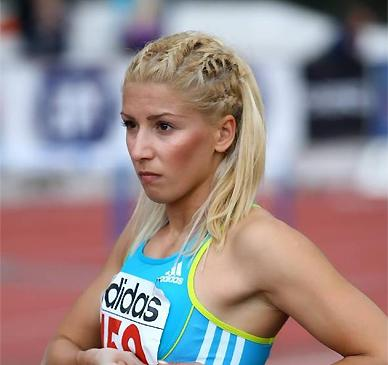 """Paraskevi """"Voula"""" Papachristou is <a href=""""http://sports.yahoo.com/blogs/olympics-fourth-place-medal/banned-greek-triple-jumper-bitter-upset-racist-tweet-162255969--oly.html"""" data-ylk=""""slk:'bitter and upset';outcm:mb_qualified_link;_E:mb_qualified_link;ct:story;"""" class=""""link rapid-noclick-resp yahoo-link"""">'bitter and upset'</a> after a racist tweet gets her kicked out of Olympics."""