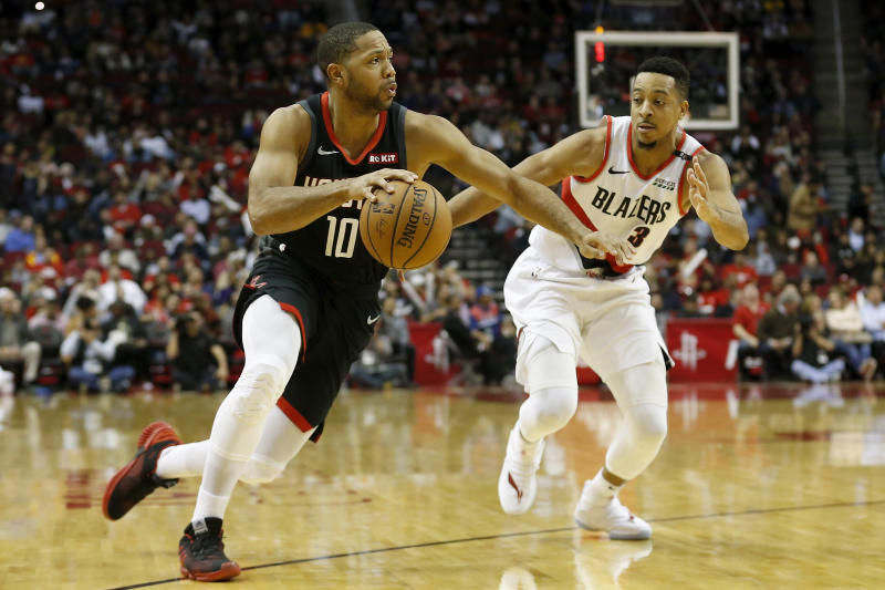 HOUSTON, TX - DECEMBER 11: Eric Gordon #10 of the Houston Rockets drives to the basket defended by CJ McCollum #3 of the Portland Trail Blazers in the second half at Toyota Center on December 11, 2018 in Houston, Texas. NOTE TO USER: User expressly acknowledges and agrees that, by downloading and or using this photograph, User is consenting to the terms and conditions of the Getty Images License Agreement. (Photo by Tim Warner/Getty Images)