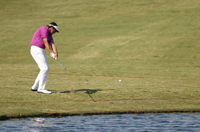 Phil Mickelson hits from the 18th fairway during the second round of the PGA Byron Nelson Championship golf tournament Friday, May 18, 2012, in Irving, Texas. (AP Photo/Tony Gutierrez)