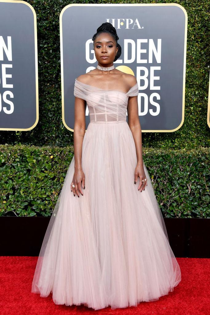 <p><i>If Beale Street Could Talk</i> star KiKi Layne wears a gauzy pink number for her Golden Globes red carpet debut. (Photo: Getty Images) </p>