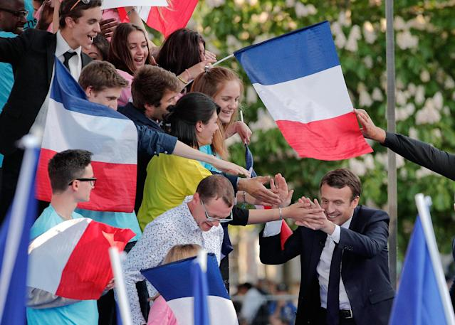 <p>French independent centrist presidential candidate Emmanuel Macron, right, touches hands with supporters during a campaign rally in Albi, southern France, Thursday, May 4, 2017. The 39-year-old independent candidate faces far-right National Front leader Marine Le Pen in Sunday's presidential runoff. (AP Photo/Christophe Ena) </p>