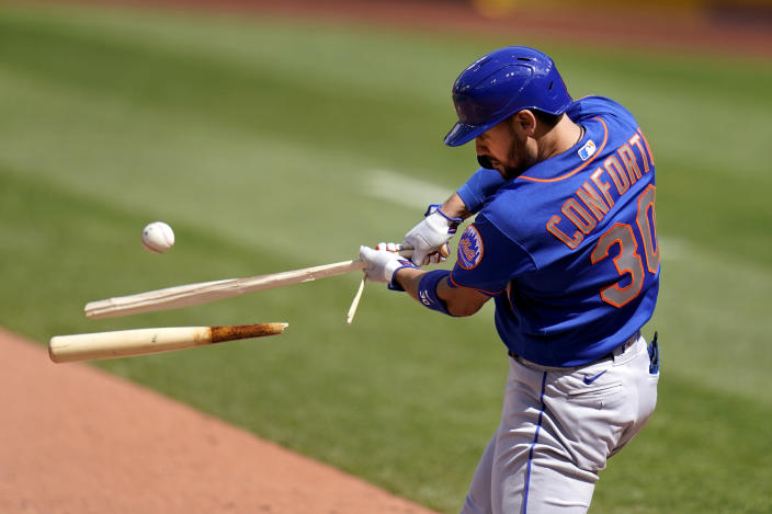 New York Mets' Michael Conforto hits a broken-bat single during the eighth inning of a baseball game against the St. Louis Cardinals Thursday, May 6, 2021, in St. Louis. (AP Photo/Jeff Roberson)
