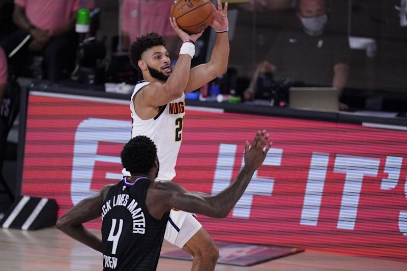 Denver Nuggets guard Jamal Murray (27) shoots past LA Clippers forward JaMychal Green (4) during the first half of an NBA conference semifinal playoff basketball game Tuesday, Sept. 15, 2020, in Lake Buena Vista, Fla. (AP Photo/Mark J. Terrill)