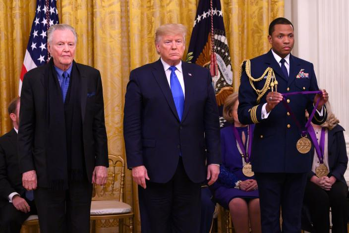 US President Donald Trump awards the National Medal of Arts to actor Jon Voight (L) in the East Room of the White House in Washington, DC, on November 21, 2019. (Photo by Andrew CABALLERO-REYNOLDS / AFP) (Photo by ANDREW CABALLERO-REYNOLDS/AFP via Getty Images)