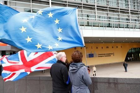 Anti-Brexit protesters hold British and European Union flags outside the EU Commission headquarters in Brussels