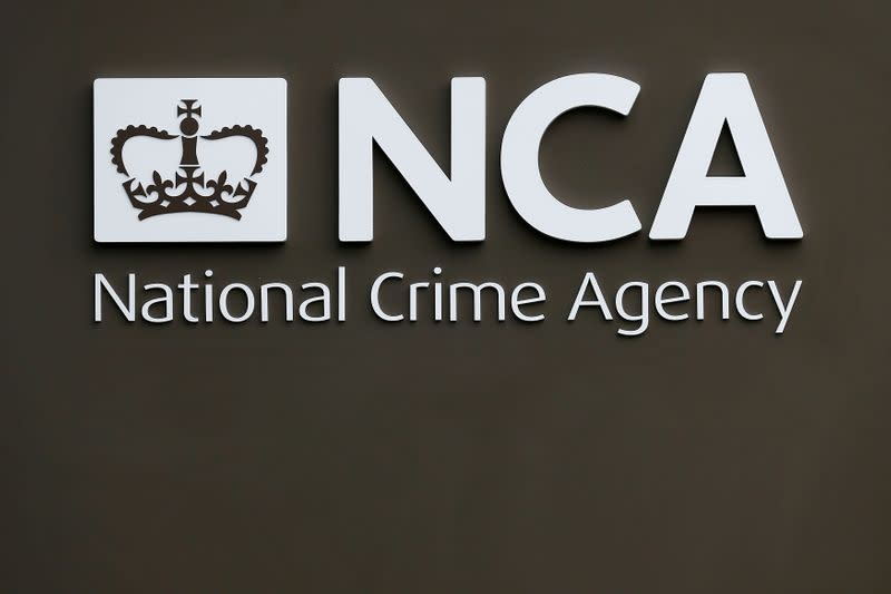 A sign is seen outside the National Crime Agency headquarters in London
