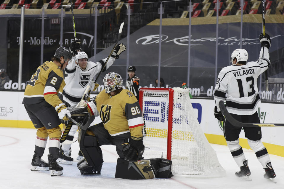 Los Angeles Kings center Lias Andersson (24) and center Gabriel Vilardi (13) celebrate after left-wing Adrian Kempe scored on Vegas Golden Knights goalie Robin Lehner (90) during the first period of an NHL hockey game Sunday, Feb. 7, 2021, in Las Vegas. (AP Photo/Isaac Brekken)