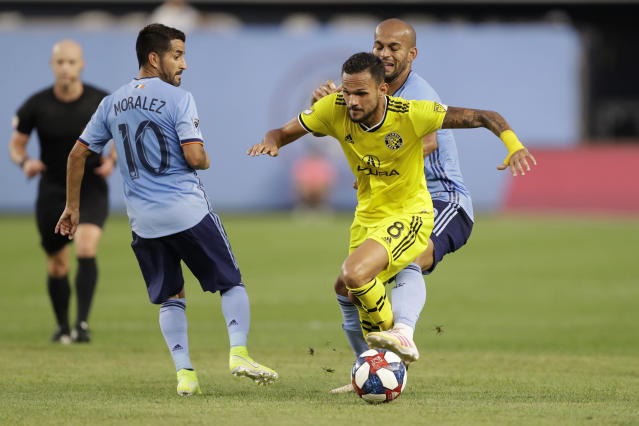 New York City FC forward Heber (9) of Brazil defends Columbus Crew midfielder Artur (8) as New York City FC midfielder Maximiliano Moralez (10) looks on during the first half of an MLS soccer match, Wednesday, Aug. 21, 2019, in New York. (AP Photo/Kathy Willens)