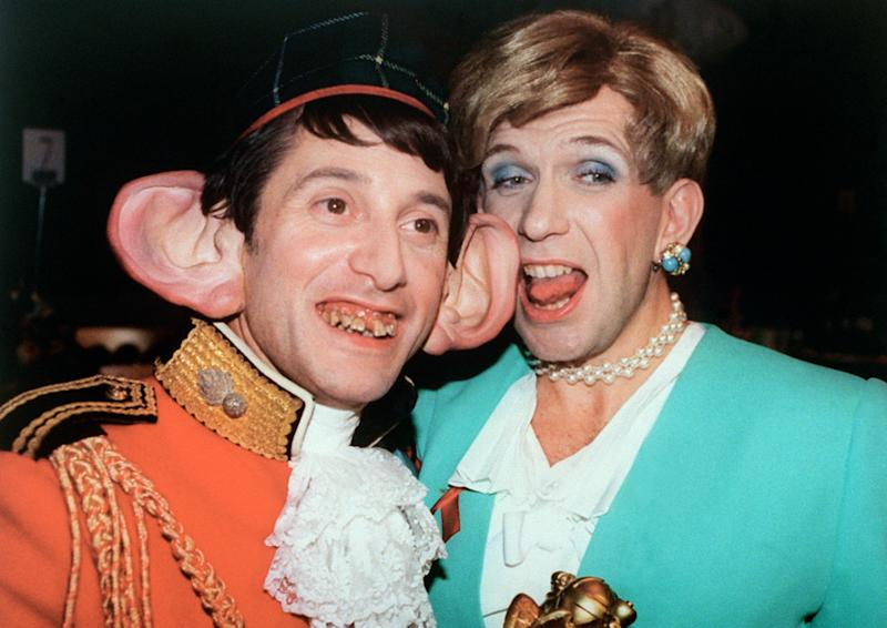 LONDON, UNITED KINGDOM - DECEMBER 3: Outrageous stars of British TV network Channel 04's Eurotrash, French Antoine de Caunes and Jean-Paul Gaultier, attend the British Comedy Awards in London 03 December 1995 in London, posing as Prince and Princess of Wales look-a-likes. AFP PHOTO NEIL MUNNS (Photo credit should read NEIL MUNNS/AFP via Getty Images)