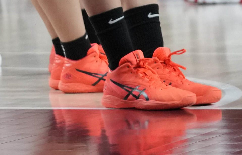 A member of Team Japan's neon Asics sneakers during a basketball preliminary round game against USA. - Credit: AP