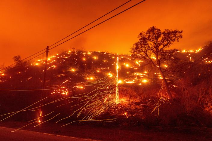 Embers burn along a hillside as the LNU Lightning Complex Fire tears through unincorporated Napa County, Calif., on Aug. 18.