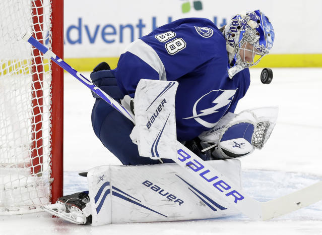 Tampa Bay Lightning goaltender Andrei Vasilevskiy (88) makes a save on a shot by the Minnesota Wild during the first period of an NHL hockey game Thursday, March 7, 2019, in Tampa, Fla. (AP Photo/Chris O'Meara)