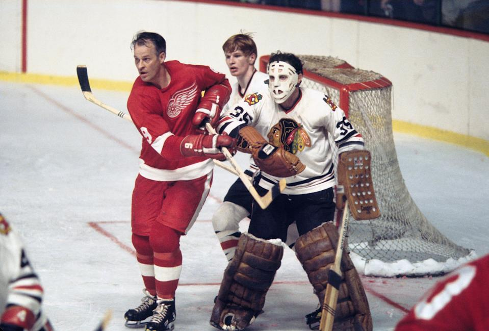 Chicago Blackhawks goalie Tony Esposito (35) and defender Keith Magnuson (3) in action against Detroit Red Wings right wing Gordie Howe (9) during the 1970 season.