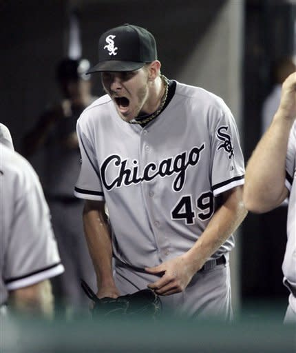 Chicago White Sox pitcher Chris Sale, who gave up a three-run home run to Detroit Tigers' Delmon Young, reacts after reaching the dugout following the sixth inning of a baseball game ,Sunday, Sept. 2, 2012, in Detroit. The Tigers took a 4-1 lead on the three-run homer. (AP Photo/Duane Burleson)