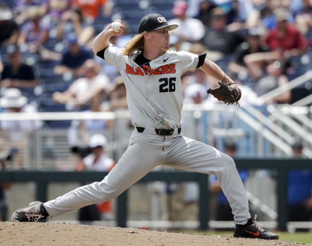 Oregon State pitcher Bryce Fehmel (26) works against Washington in the fourth inning of an NCAA College World Series baseball elimination game in Omaha, Neb., Monday, June 18, 2018. (AP Photo/Nati Harnik)