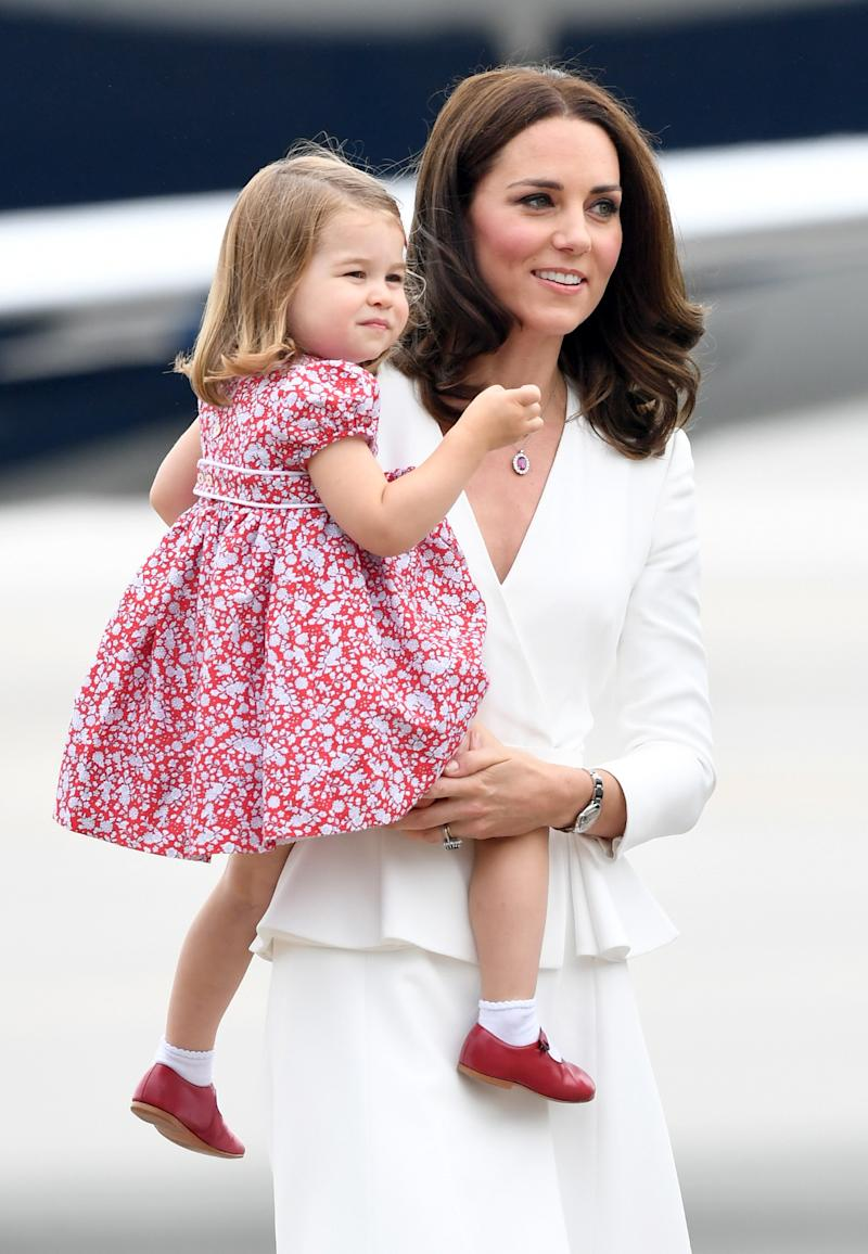 Duchess Catherine looked fresh and lovely in an all-white ensemble, while Princess Charlotte stole the show in a red printed high-waist dress, with little white socks and red mary-jane shoes.
