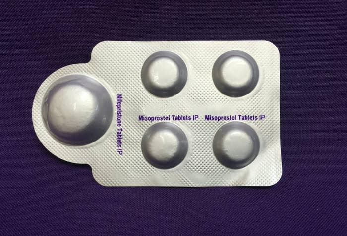 a combination pack of mifepristone (L) and misoprostol tablets, two medicines used together, also called the abortion pill