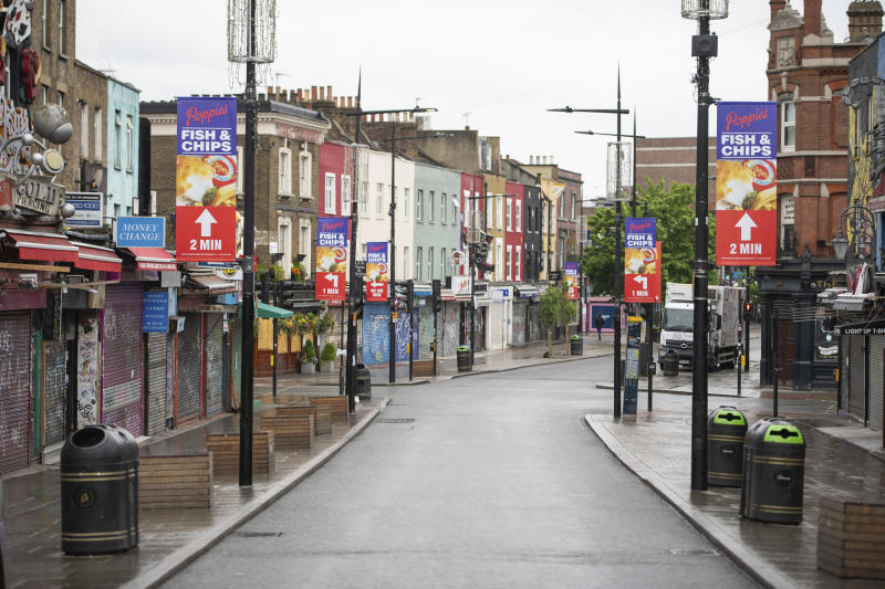 A general view of a deserted Camden High Street, as the UK continues its lockdown to help curb the spread of coronavirus, in London, Wednesday April 29, 2020. (Dominic Lipinski/PA via AP)