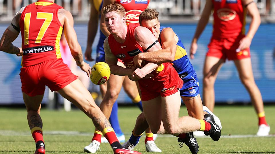 Matt Rowell, pictured here being injured in a tackle by Zac Langdon.