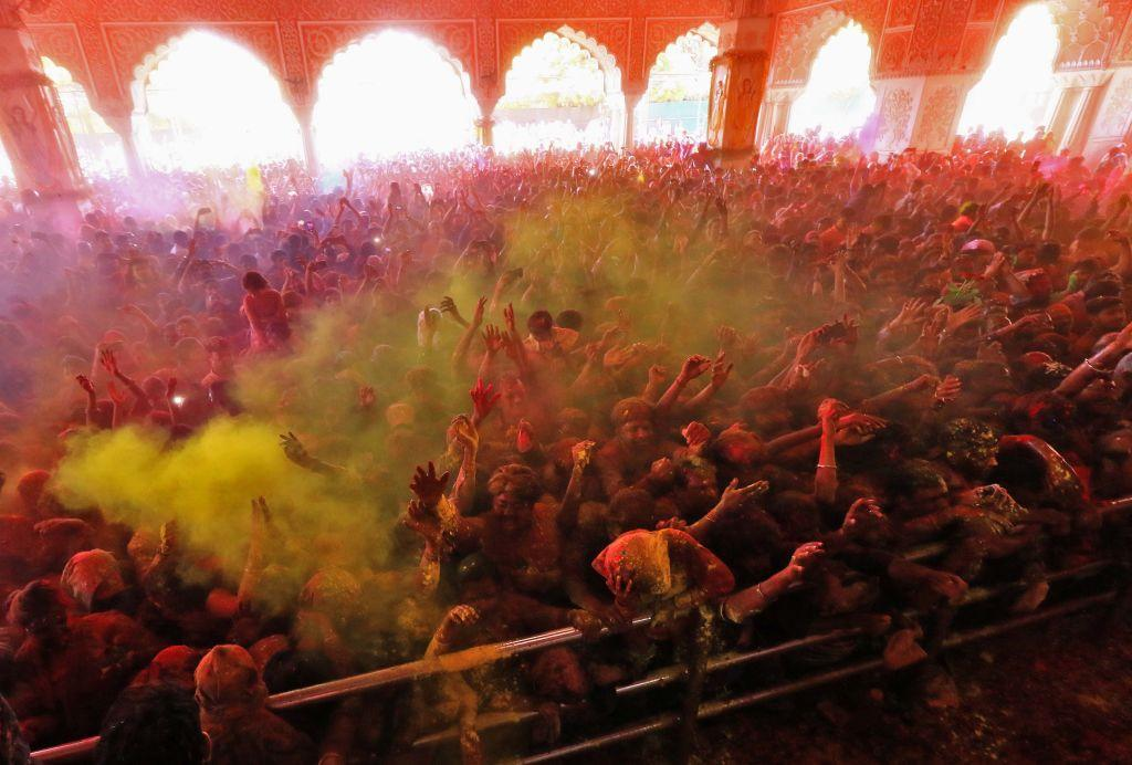 <p>Devotees play with colours as they celebrate Holi festival at historical Govind Dev Ji Temple in Jaipur, Rajasthan, India on March 20, 2019. Holi, the popular Hindu spring festival of colours is observed in India at the end of the winter season on the last full moon of the lunar month. (Photo from Vishal Bhatnagar/NurPhoto) </p>