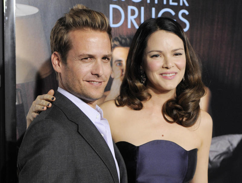 """FILE - This Nov. 4, 2010 file photo shows actors Gabriel Macht, left, and his wife, actress Jacinda Barrett at the premiere of the film """"Love & Other Drugs"""" on the opening night of American Film Institute's AFI Fest 2010 in Los Angeles. Macht of the USA Network series """"Suits,"""" says his wife Jacinda Barrett will have an arc in the show's second season premiering Thursday, June 14, 2012. (AP Photo/Chris Pizzello, file)"""