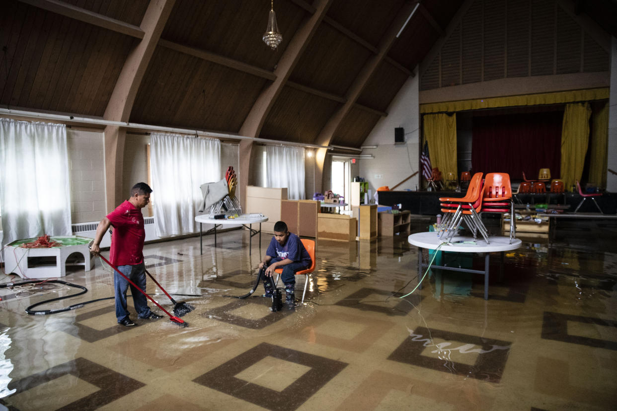 Parishioners pump out floodwater inside the Macedonia Baptist Church in Westville, N.J. Thursday, June 20, 2019. Severe storms containing heavy rains and strong winds spurred flooding across southern New Jersey, disrupting travel and damaging some property. (Photo: Matt Rourke)/AP
