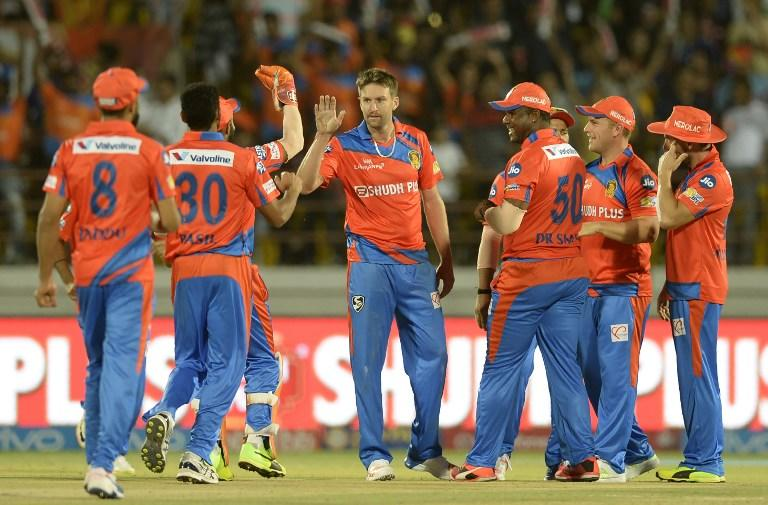 <p>Gujarat Lions cricketer Andrew Tye (C) celebrates with teammates after taking the wicket of Rising Pune Supergiant batsman Ben Stokes during the 2017 Indian Premier League (IPL) Twenty20 cricket match between Gujarat Lions and Rising Pune Supergiant at The Saurashtra Cricket Association Stadium in Rajkot on April 14, 2017. ——IMAGE RESTRICTED TO EDITORIAL USE – STRICTLY NO COMMERCIAL USE—– / GETTYOUT—— / AFP PHOTO / PUNIT PARANJPE / —-IMAGE RESTRICTED TO EDITORIAL USE – STRICTLY NO COMMERCIAL USE—– / GETTYOUT </p>