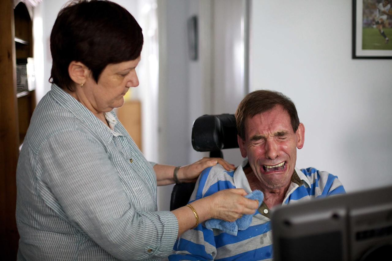 Tony Nicholson, 58, who suffered from locked-in syndrome, died in August a week after losing a legal bid to end his life with a doctor's help. Mr Nicklinson suffered a stroke in 2005 and was paralysed from the neck down. Judges ruled that a doctor's assistance would be murder and such a change in law would have to be made by Parliament. Mr Nicklinson's family are continuing the right-to-die campaign (SWNS)