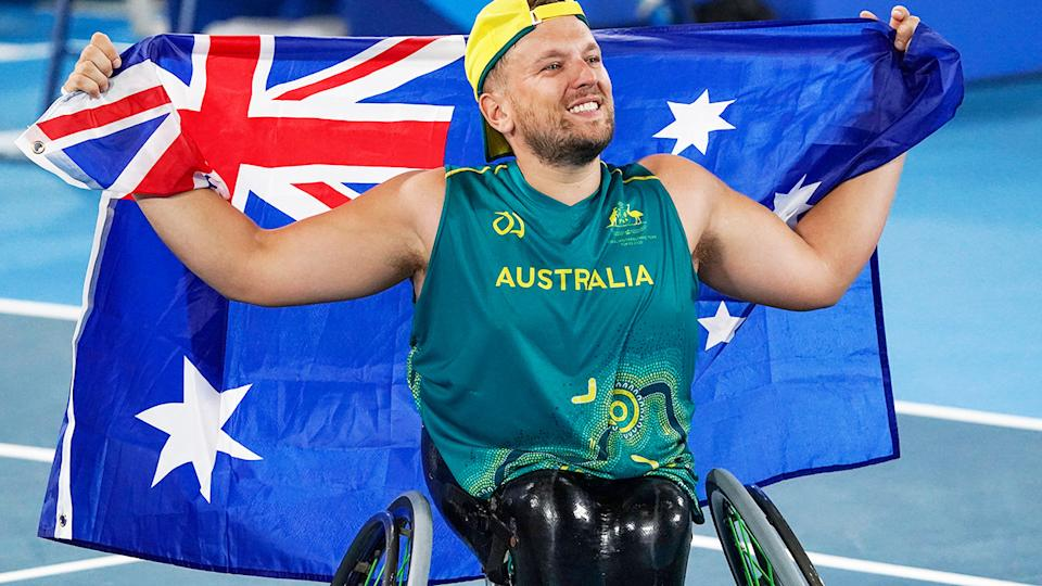 Dylan Alcott, pictured here after winning gold at the Tokyo Paralympics.