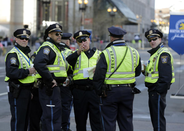 Boston Police officers receive instructions from their supervisor near the finish line before the 118th Boston Marathon Monday, April 21, 2014 in Boston. (AP Photo/Robert F. Bukaty)