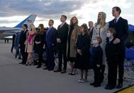 Ivanka Trump (2nd R), husband Jared Kushner (R), their children, Eric (C-R) and Donald Jr. (C-R) and Trump family members stand on the tarmac at Joint Base Andrews in Maryland as they arrive for US President Donald Trump's departure on January 20, 2021. - President Trump travels to his Mar-a-Lago golf club residence in Palm Beach, Florida, and will not attend the inauguration for President-elect Joe Biden. (Photo by ALEX EDELMAN / AFP) (Photo by ALEX EDELMAN/AFP via Getty Images)