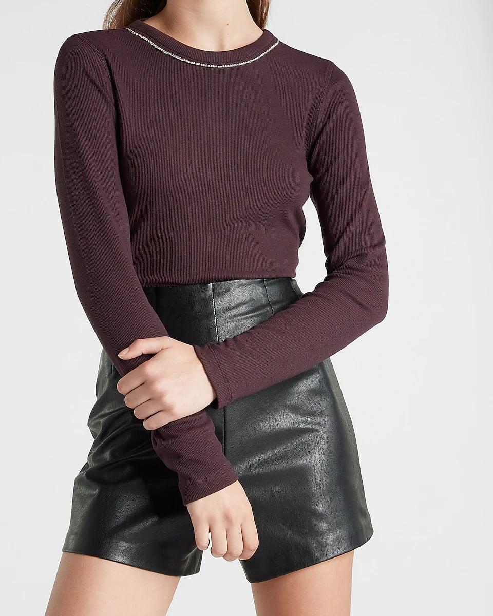 <p>Elegant for the office yet polished enough for happy hour, this <span>Express Embellished Crew Neck Top</span> ($64) will become a favorite among your work clothes. The color is particularly fall-friendly, and the embellished neckline makes it exciting.</p>