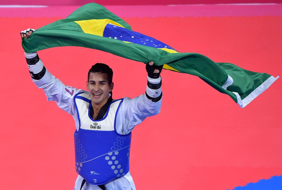 Brazil's Edival Marques celebrates after winning the gold medal in the Taekwondo Men's Under 68kg Final against Dominican Bernardo Pie during the Pan-American Games Lima 2019, in Lima, on July 28, 2019. (Photo by Luis ACOSTA / AFP)        (Photo credit should read LUIS ACOSTA/AFP via Getty Images)