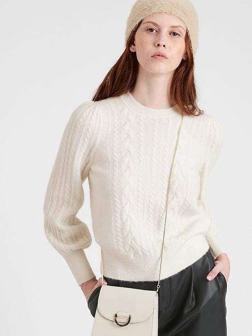 <p><span>Banana Republic Cable-Knit Puff-Sleeve Sweater</span> ($99, plus 50 percent off)</p>
