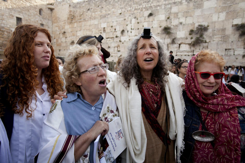 Israeli women pray at the Western Wall in Jerusalem, Thursday, April 11, 2013. Israeli police have detained five women while praying at the Western Wall in Jerusalem for performing religious rituals that ultra-Orthodox Jews say are reserved for men. Police spokesman said about 120 woman arrived for their monthly prayer service Thursday and five were detained for wearing prayer shawls.(AP Photo/Michal Fattal)
