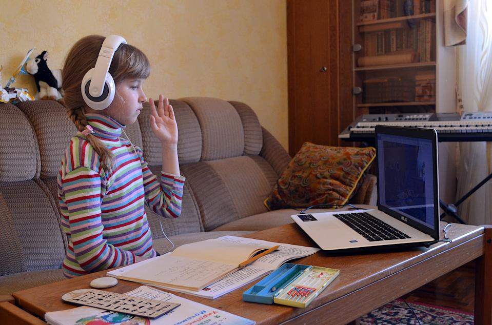 If you've purchased additional laptops and furniture to support your child's remote learning, that should be communicated to your child when talking about their wish list.(Yevhen Kotenko/ Ukrinform/Barcroft Media via Getty Images)