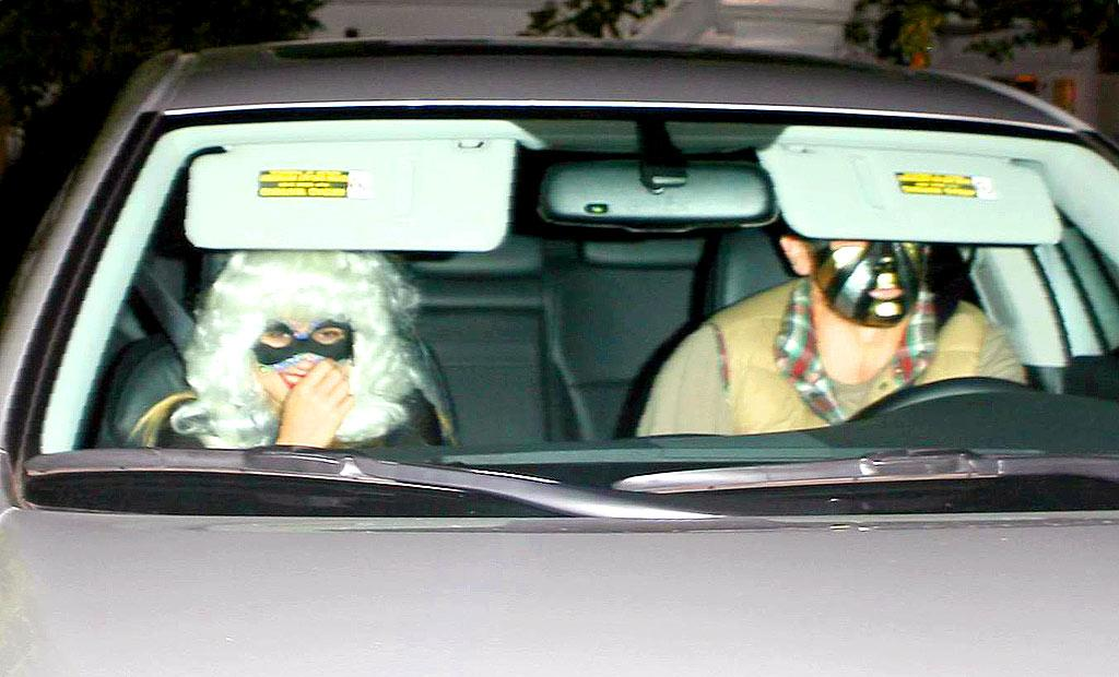 """The masks can't fool us. Rumored couple Reese Witherspoon and Jake Gyllenhaal are spotted en route to Kate Hudson's Halloween bash in Brentwood, CA. MWD/<a href=""""http://www.x17online.com"""" target=""""new"""">X17 Online</a> - October 27, 2007"""