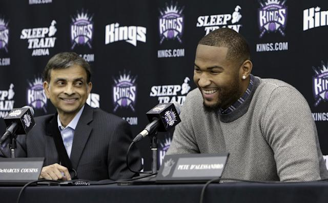 Sacramento Kings majority owner Vivek Ranadive and Kings center DeMarcus Cousins laugh during a news conference to announce Cousins' signing of four-year contract extension, in Sacramento, Calif., Monday, Sept.30, 2013. (AP Photo/Rich Pedroncelli)