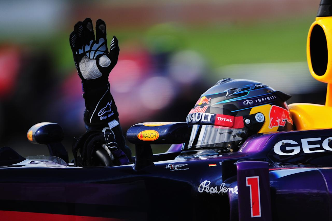 MONTREAL, QC - JUNE 09: Sebastian Vettel of Germany and Infiniti Red Bull Racing celebrates after winning the Canadian Formula One Grand Prix at the Circuit Gilles Villeneuve on June 9, 2013 in Montreal, Canada. (Photo by Shaun Botterill/Getty Images)