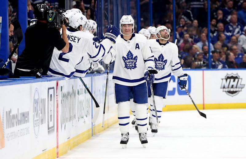 Jan 17, 2019; Tampa, FL, USA; Toronto Maple Leafs center Patrick Marleau (12) is congratulated after scoring a goal against the Tampa Bay Lightning during the second period at Amalie Arena. Mandatory Credit: Kim Klement-USA TODAY Sports