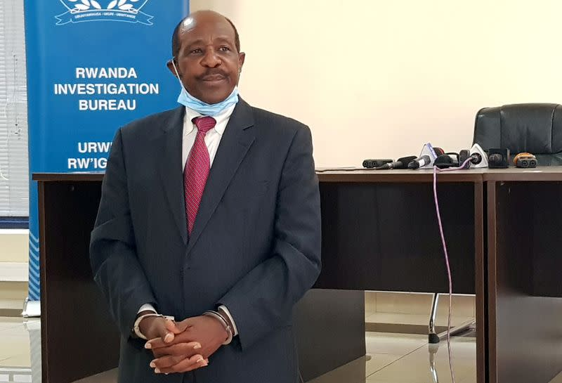 FILE PHOTO: Rusesabagina is detained and paraded in front of media in handcuffs in Kigali