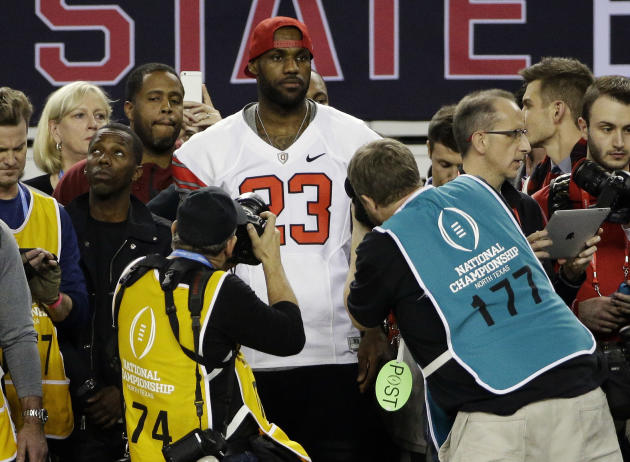 NBA basketball player LeBron James stands on the sideline during the second half of the NCAA college football playoff championship between Ohio State and Oregon game Monday, Jan. 12, 2015, in Arlington, Texas. Ohio State won 42-20. (AP Photo/David J. Phillip)