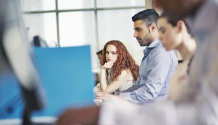 Woman in row of office workers